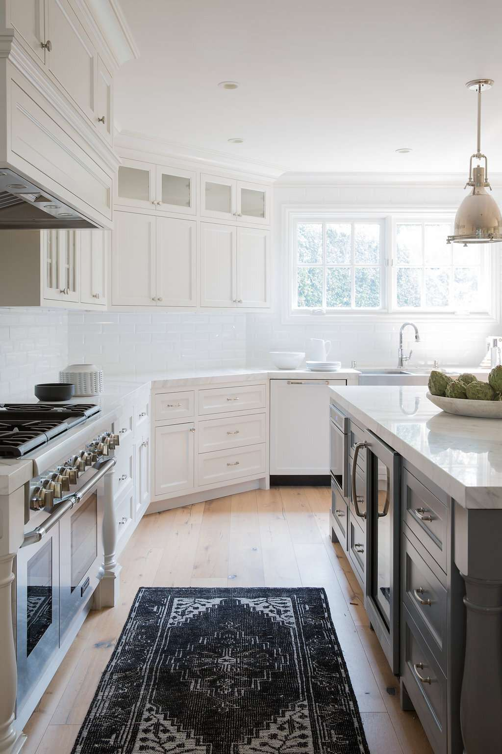 All white kitchen with dark colored, patterned runner