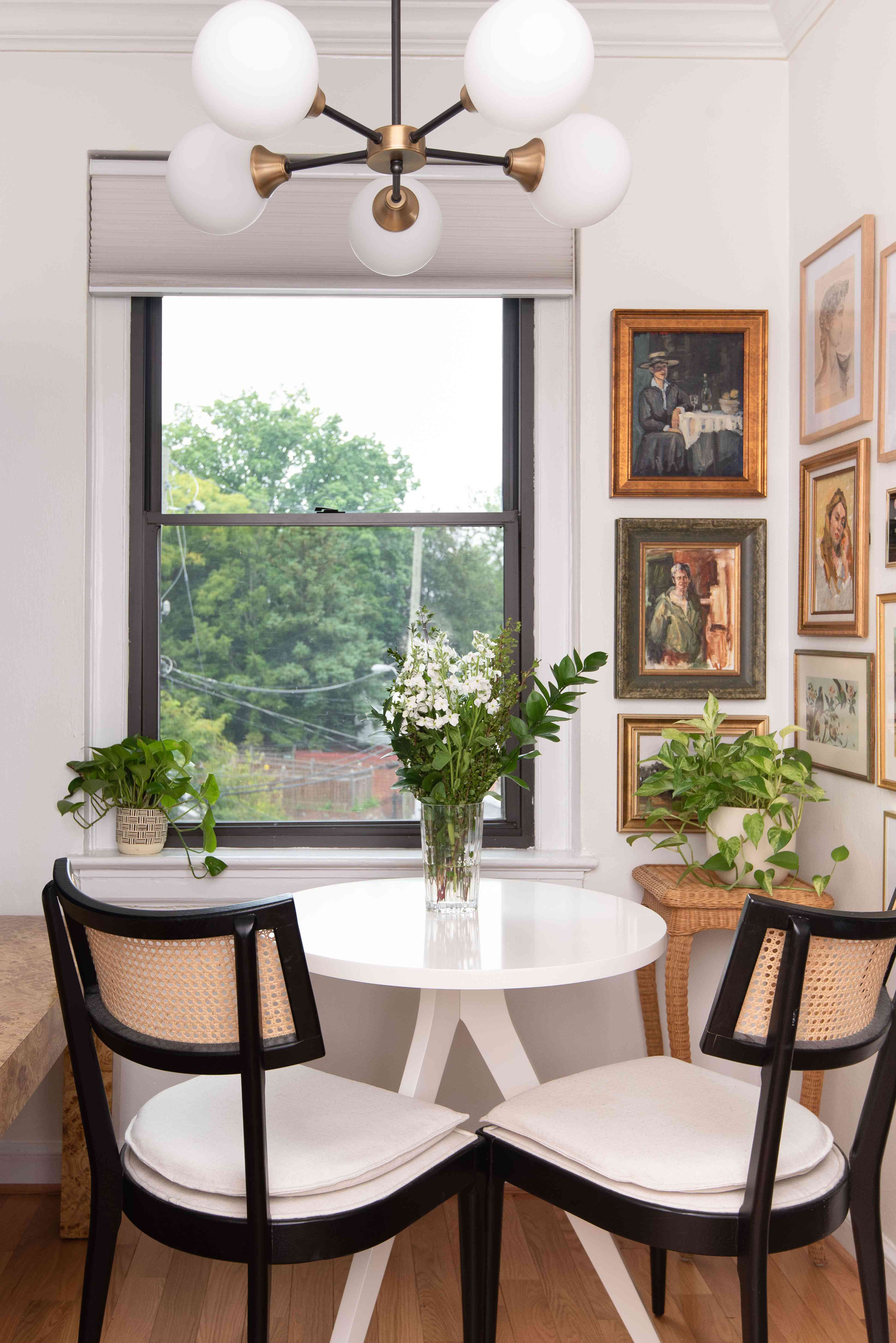 Small dining area with window and gallery wall.