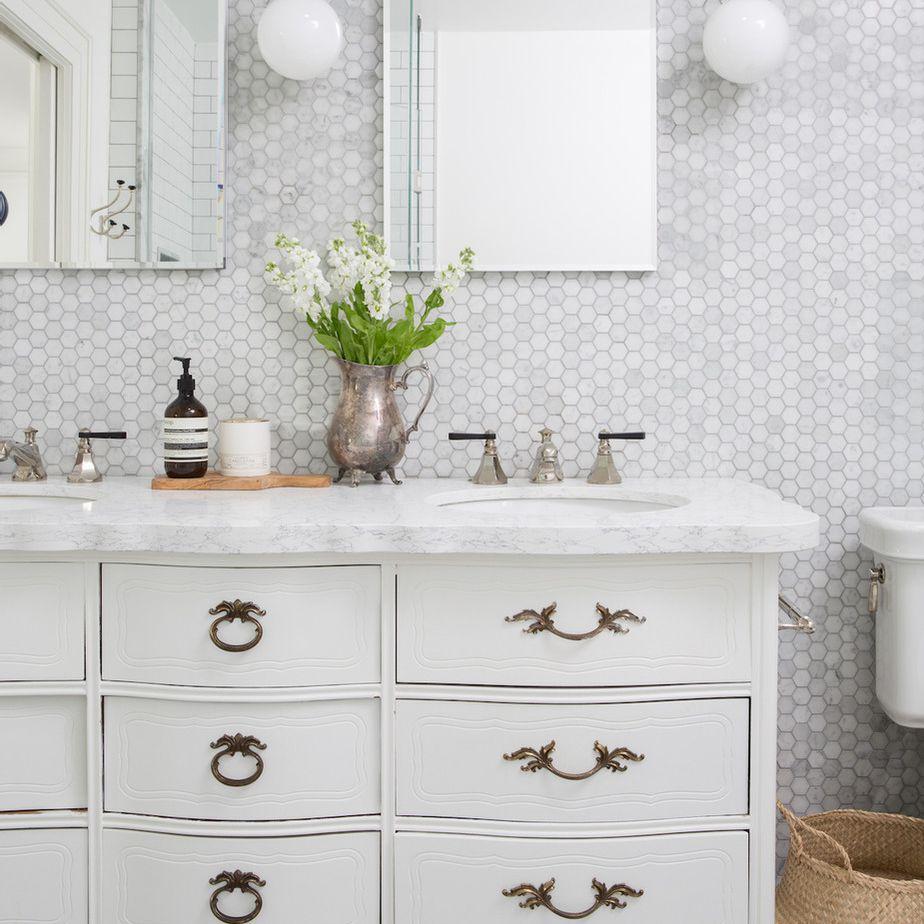 Modern vintage bathroom with repurposed dresser vanity