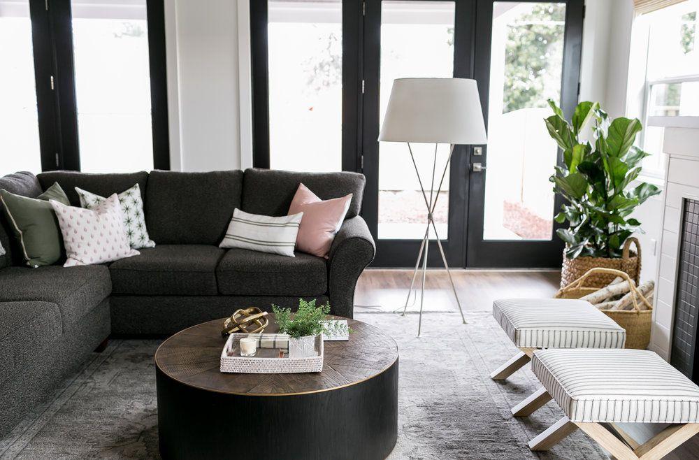 dark gray couch in living room with black door frames