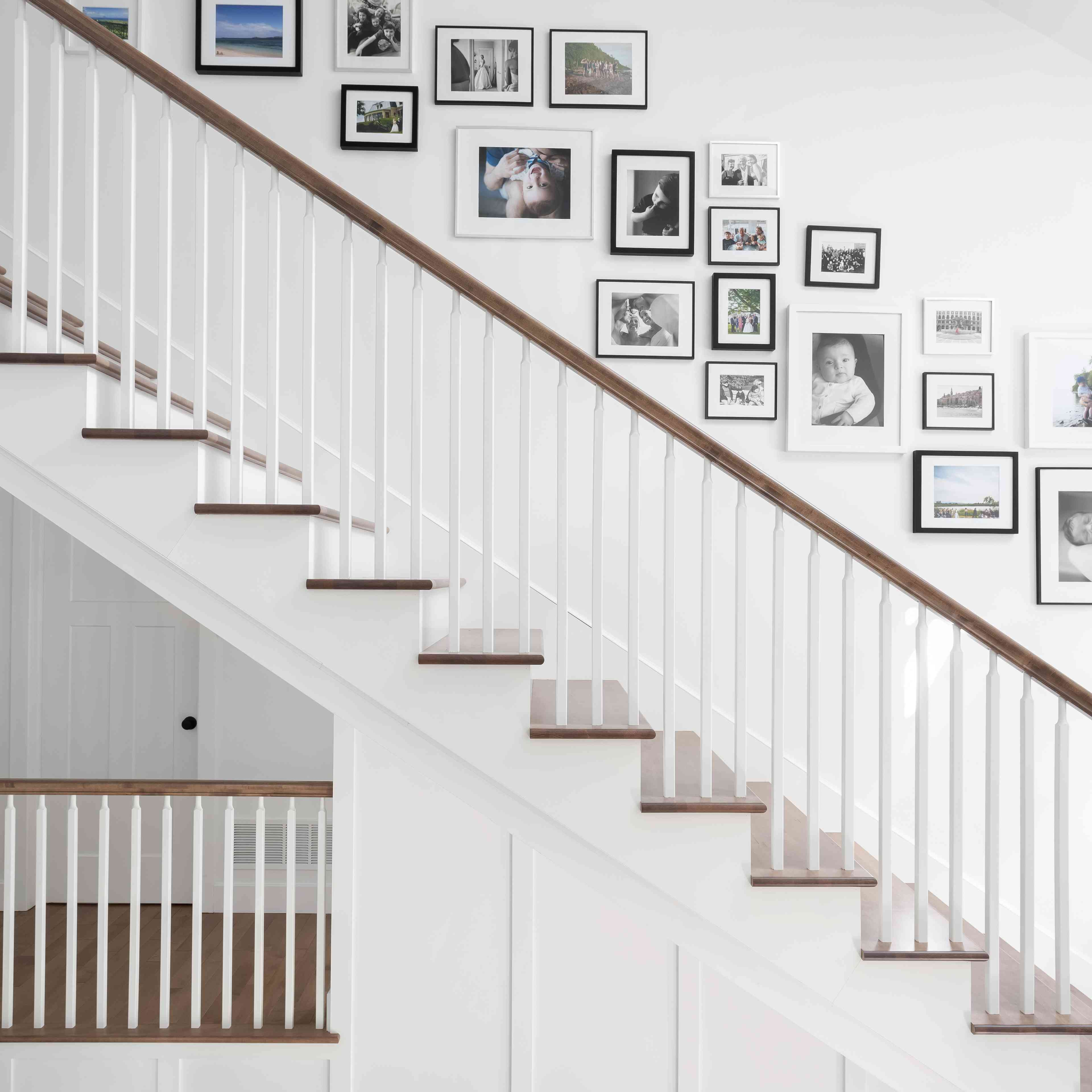 Family photos hung on the wall of a staircase