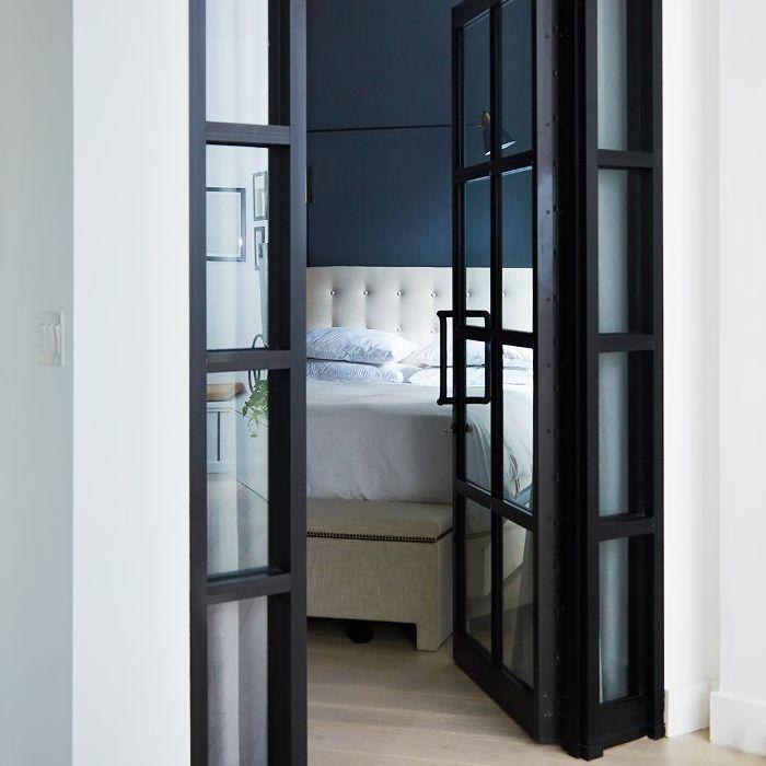 a look into the bedroom through a doorway