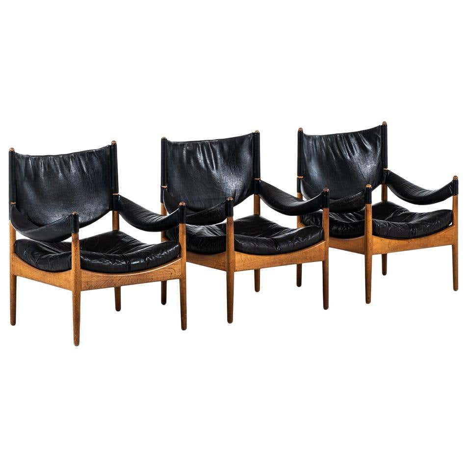 A set of three leather and teak Kristian Solmer Vedel for Søren Willadsen midcentury modern lounge chairs.