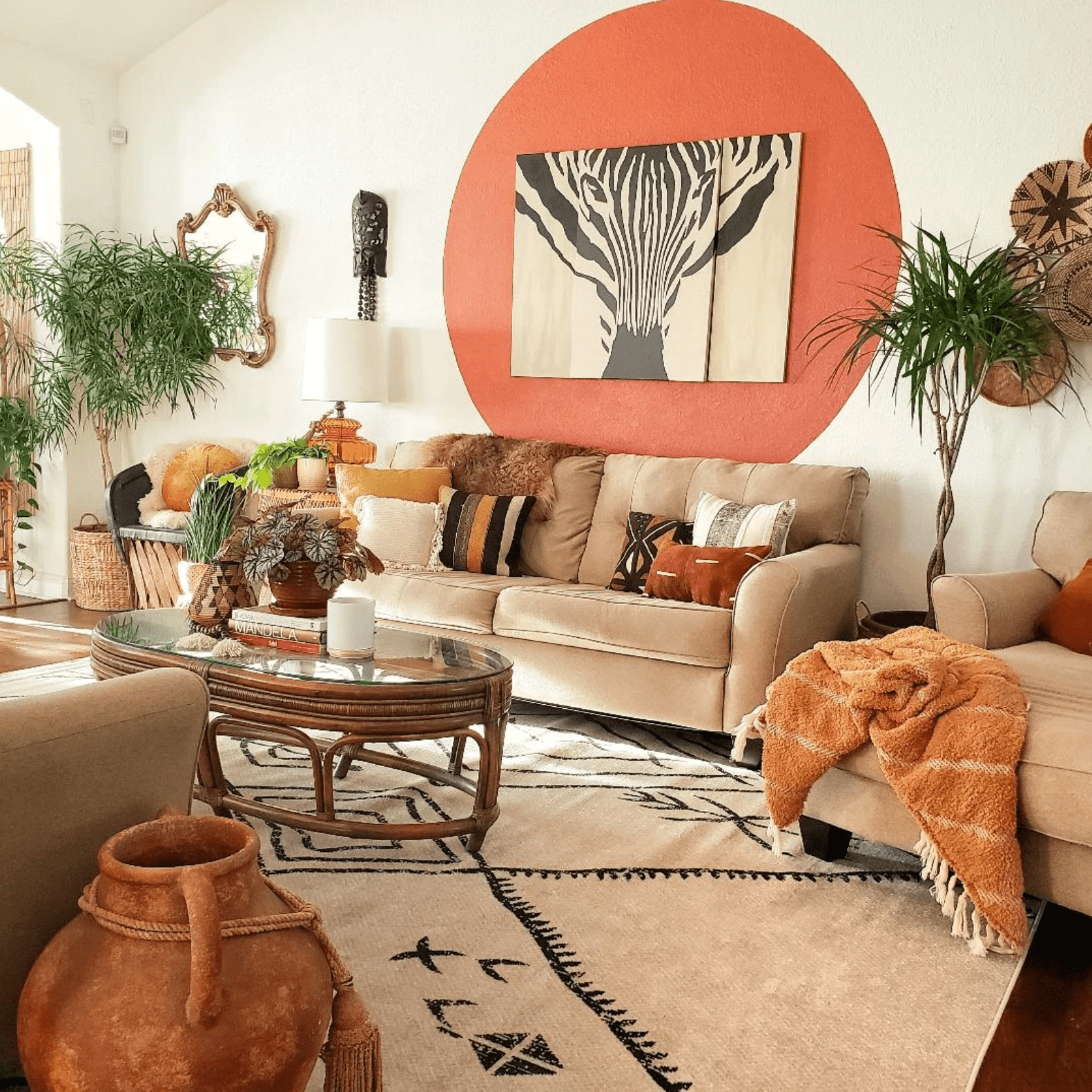 A living room full of earthy colors and prints