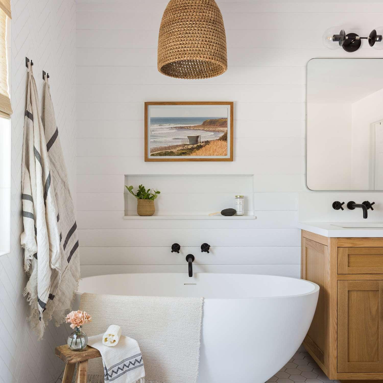 A bathroom with a woven light fixture
