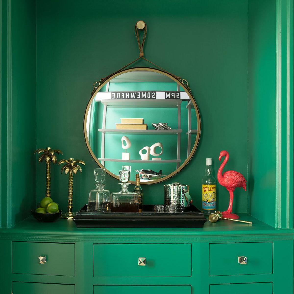 Bright green dresser used as a bar cart.