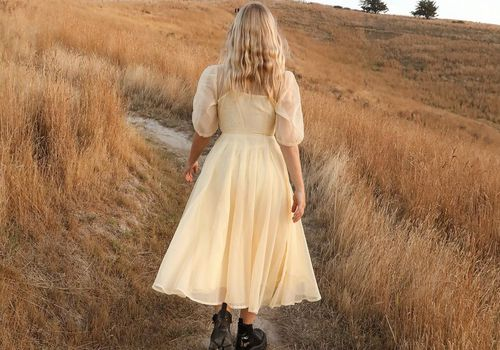 Woman walking through the countryside.