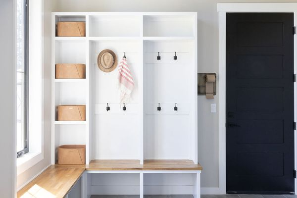 Organized mudroom with built-in shelving.
