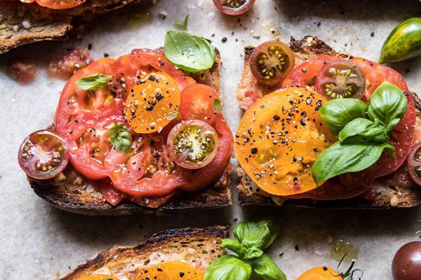 how to grow tomatoes - garlicky heirloom tomato, basil, and manchengo toast
