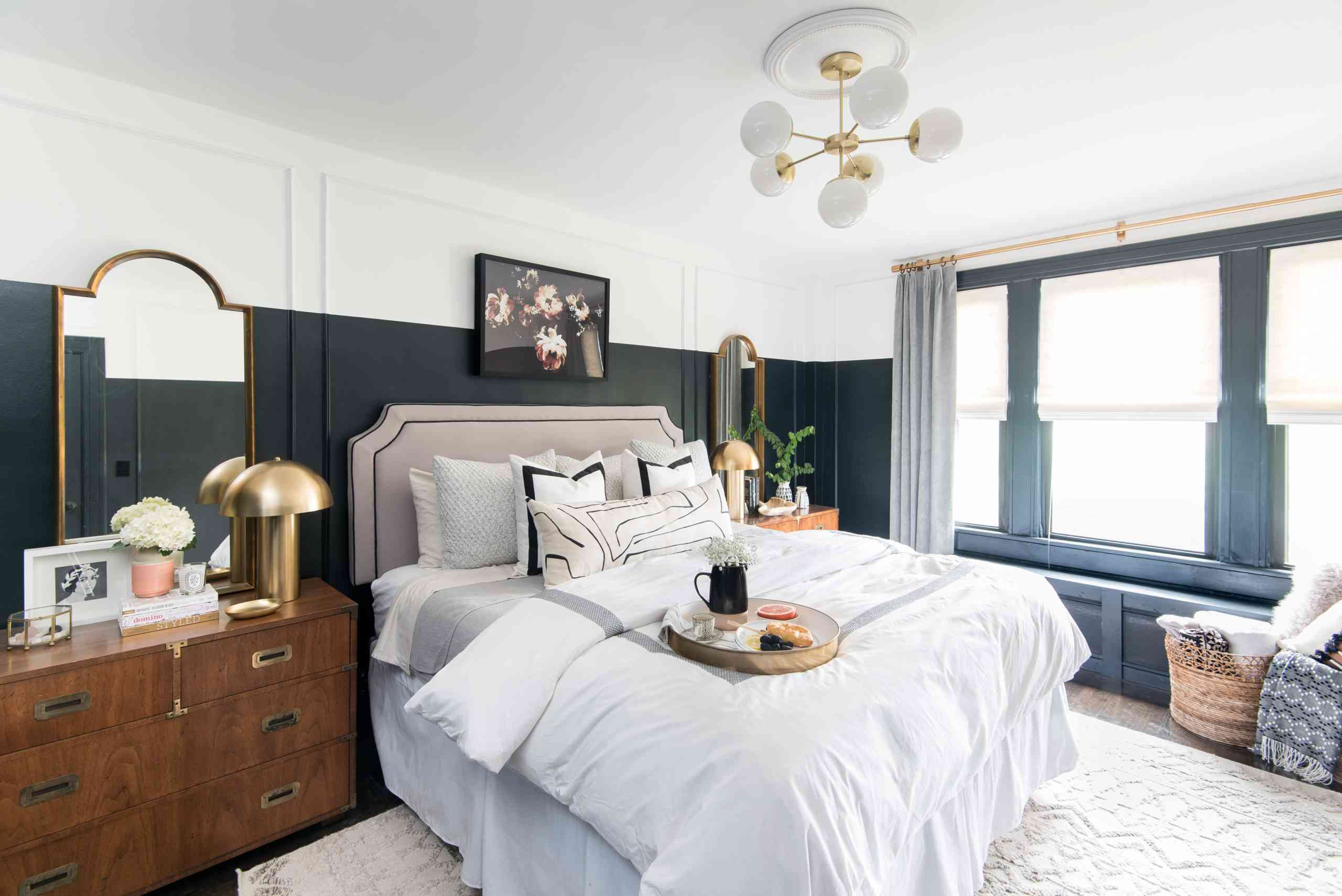 Ornate bedroom with large gold mirror and mushroom lamp.