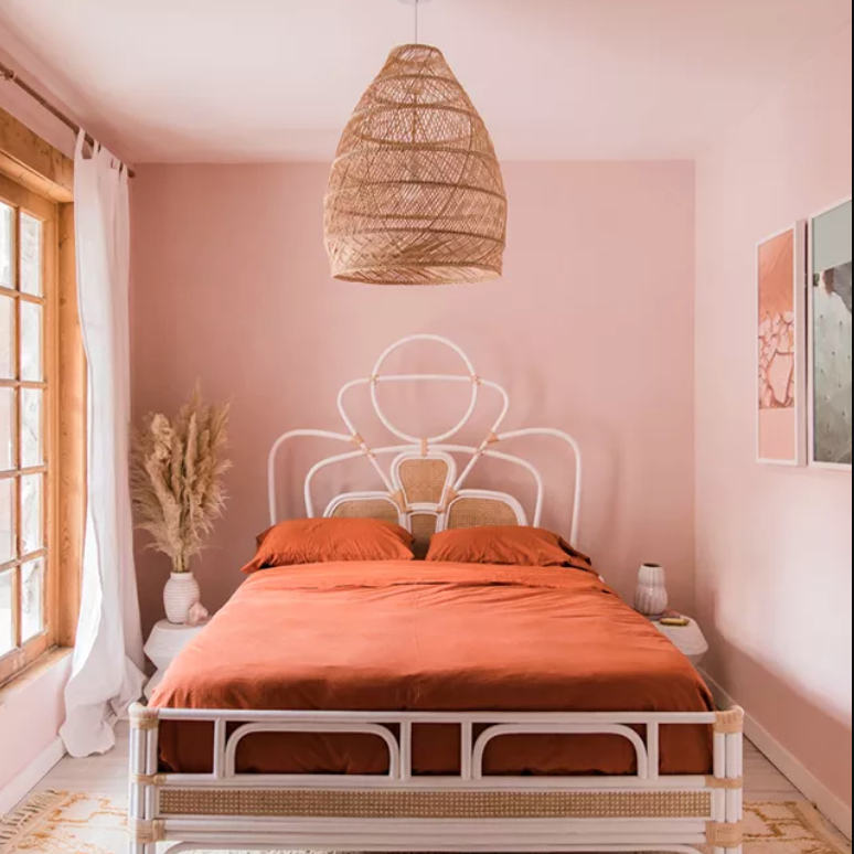 Pink bedroom with large patterned rug