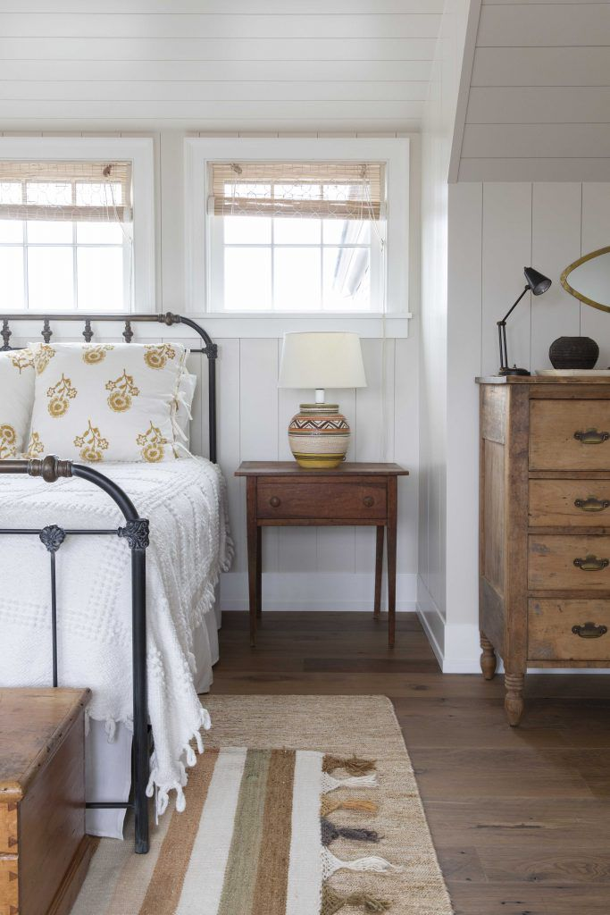 A rustic bedroom with floral linens