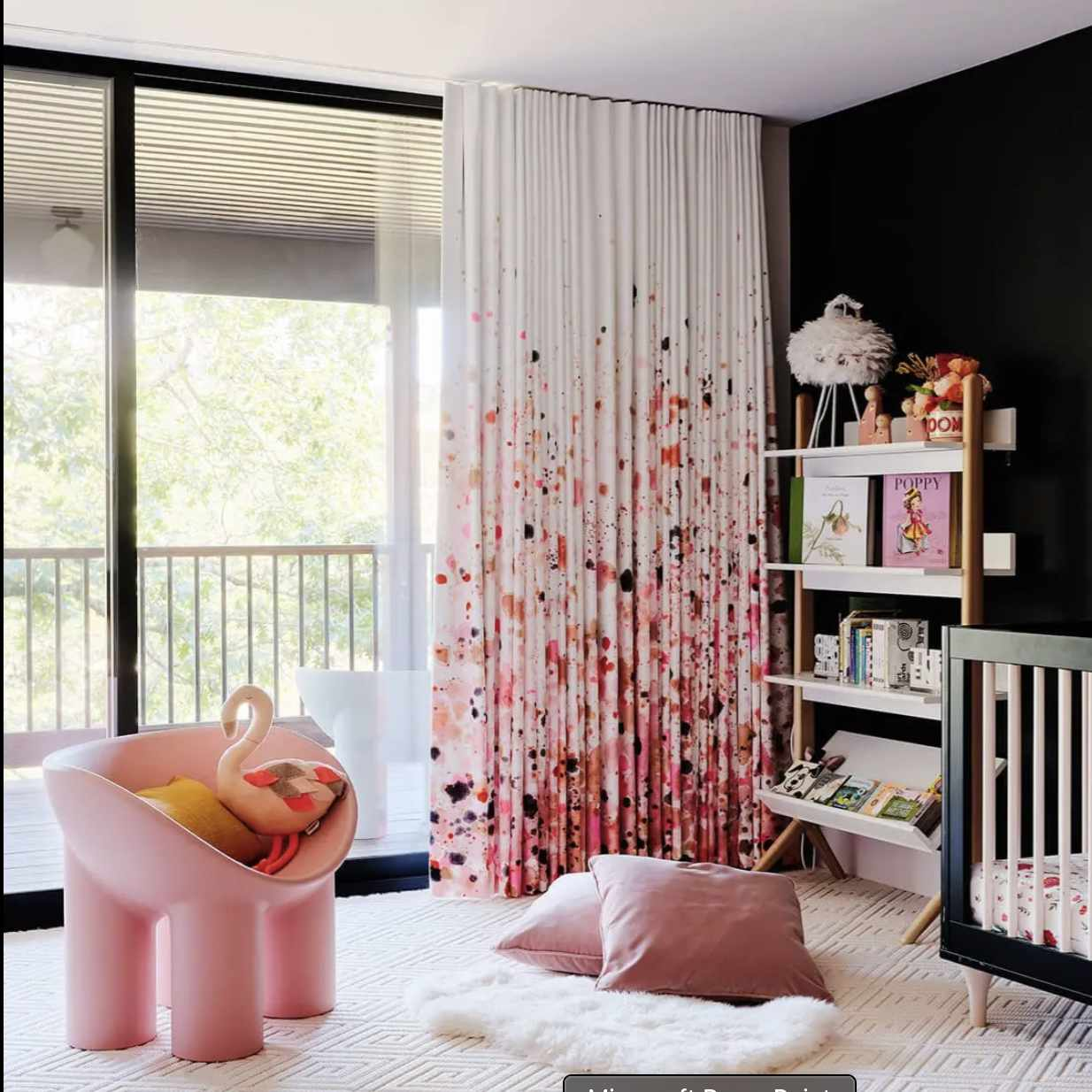 nursery with black walls and pink accessories