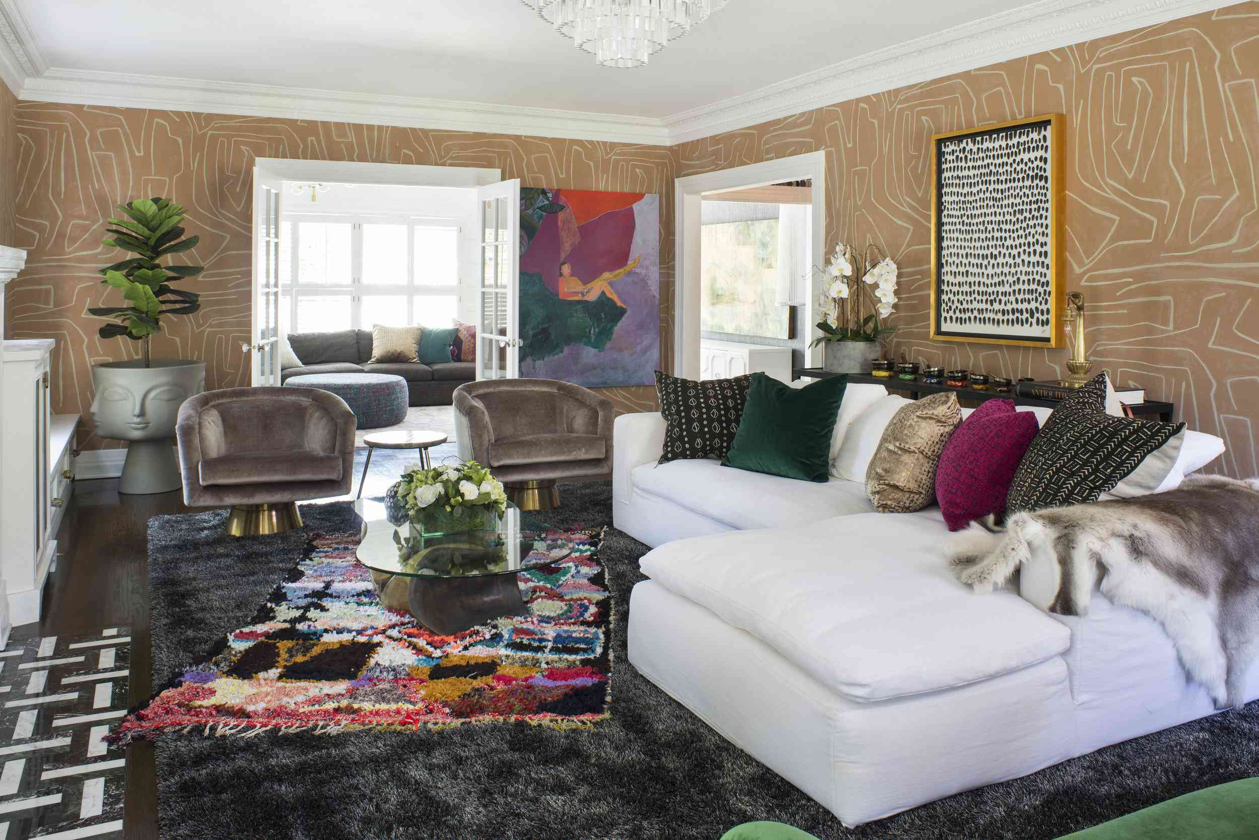 best living room ideas - maximalist living room with wallpaper and layered rugs