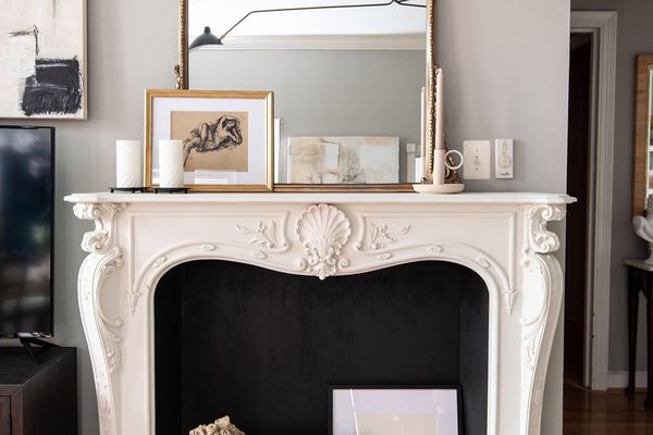 Ornate mirror on top of white mantle.