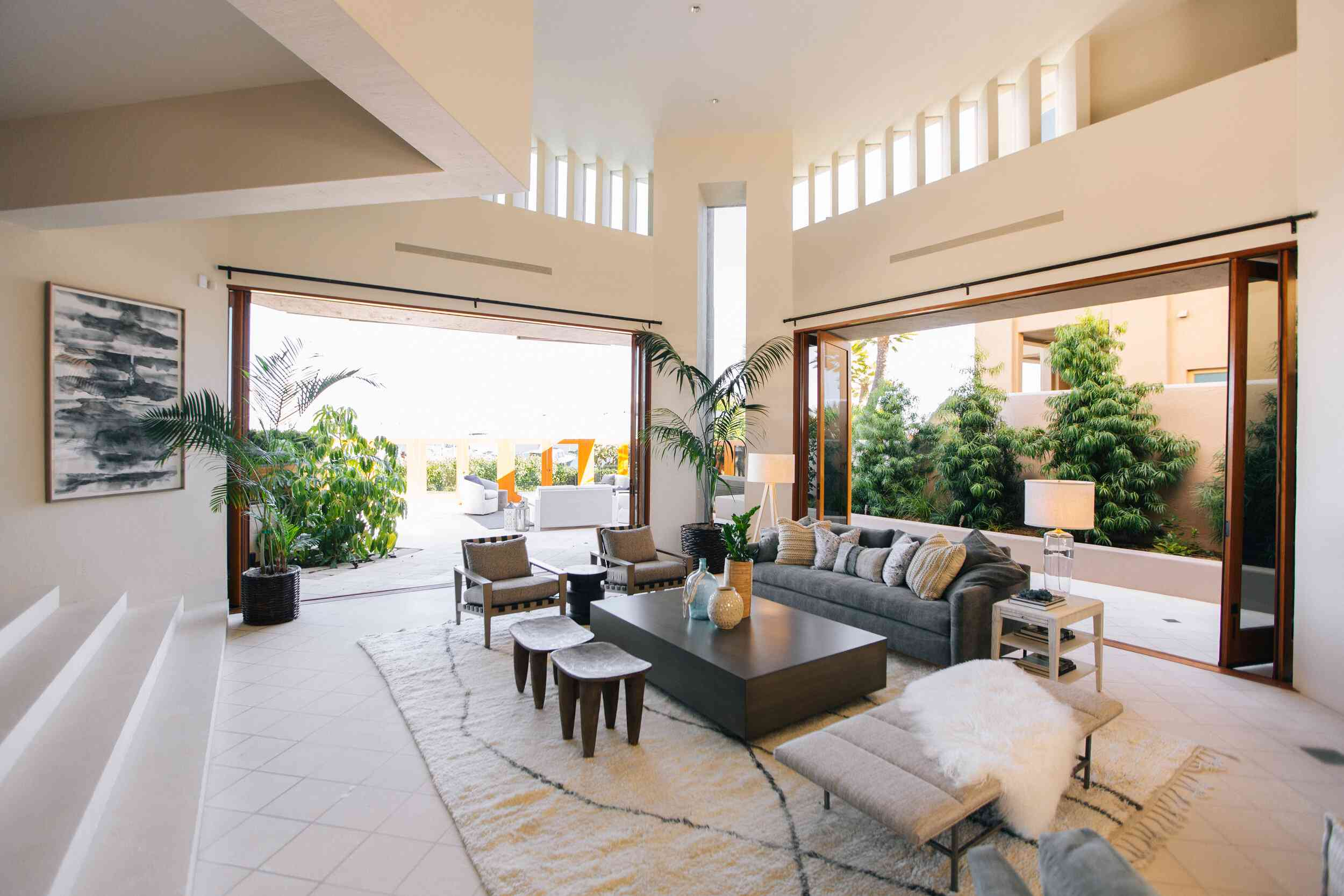 Grand tropical family room that extends to outside.