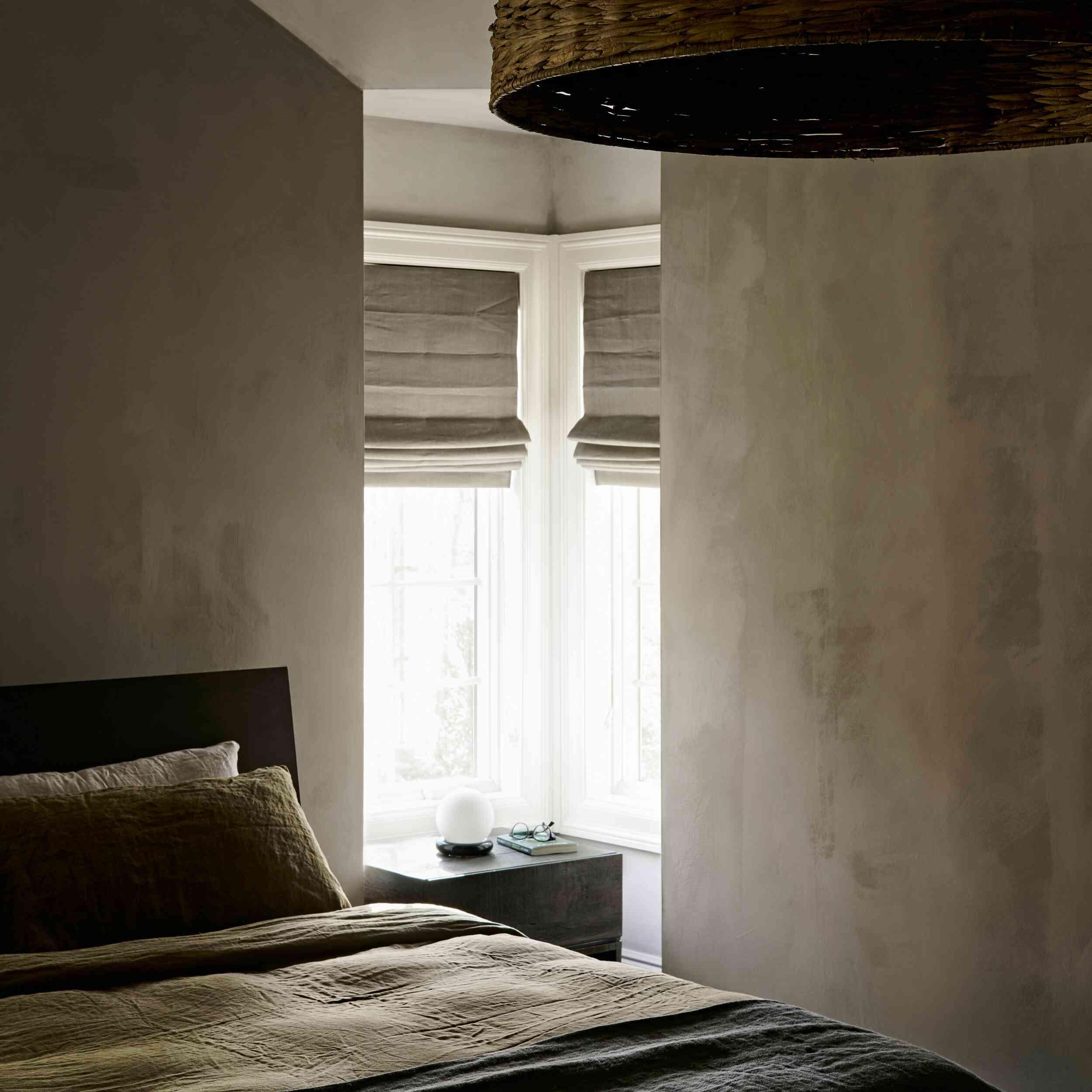Moody bedroom with matte gray textured walls