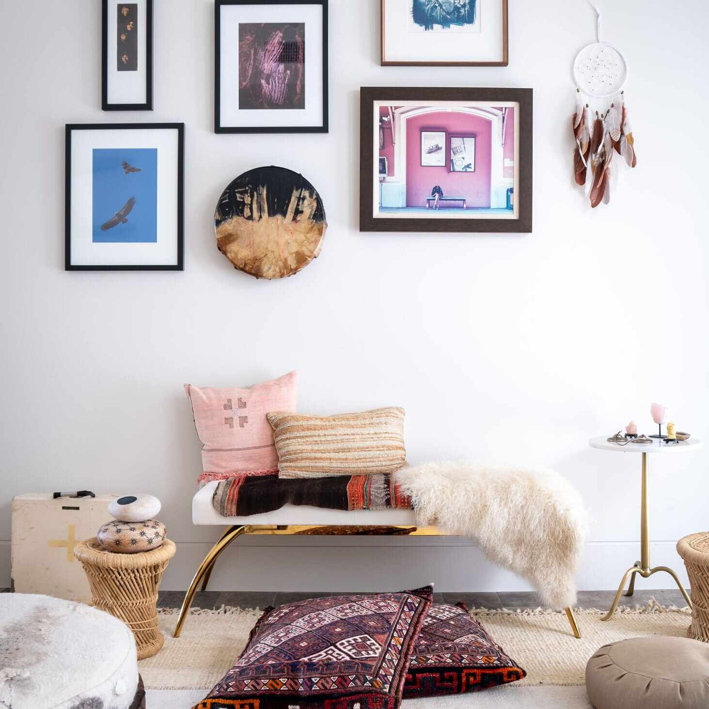 Global eclectic styled living area with bench, throw pillows, and art