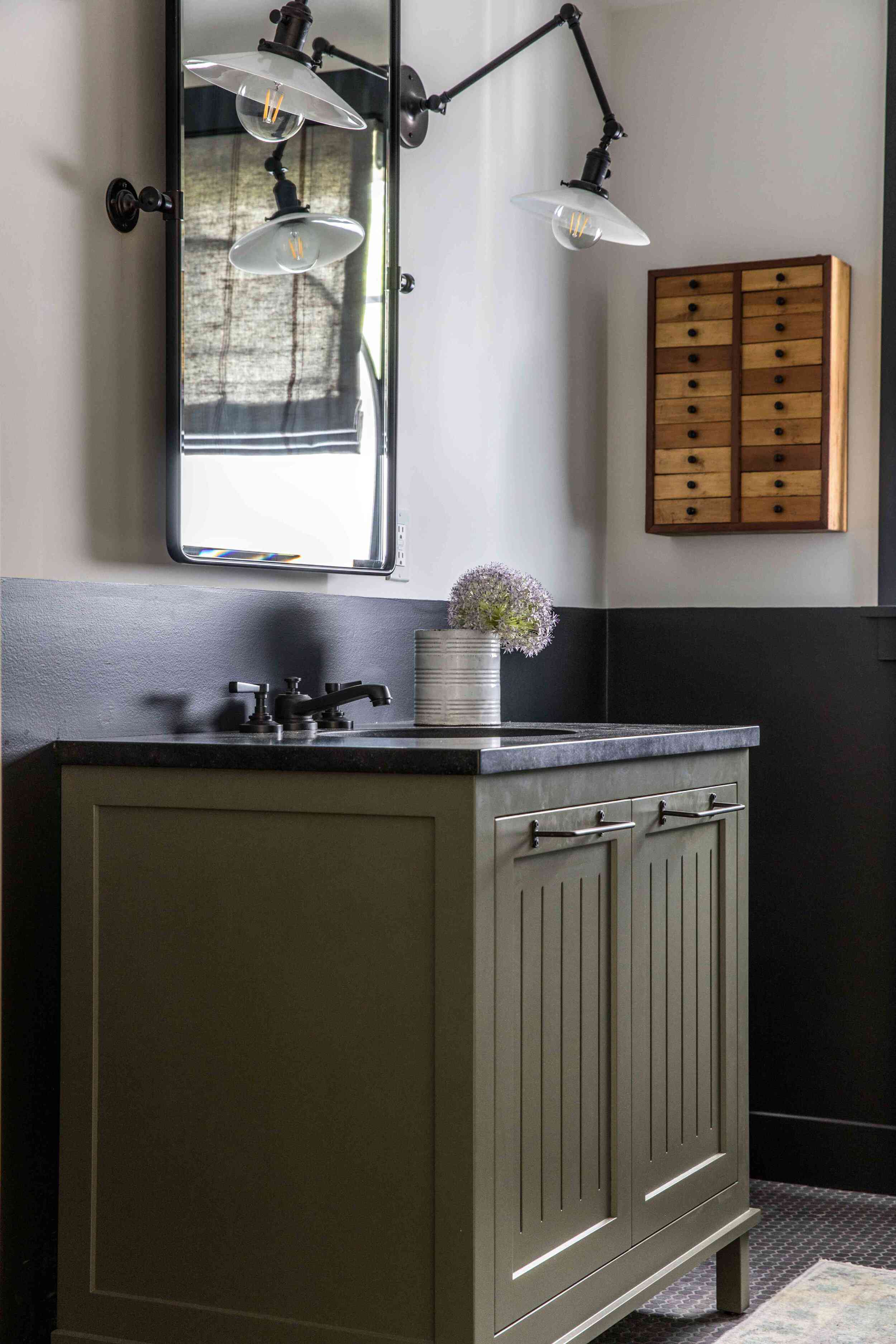 Bathroom with dark green vanity