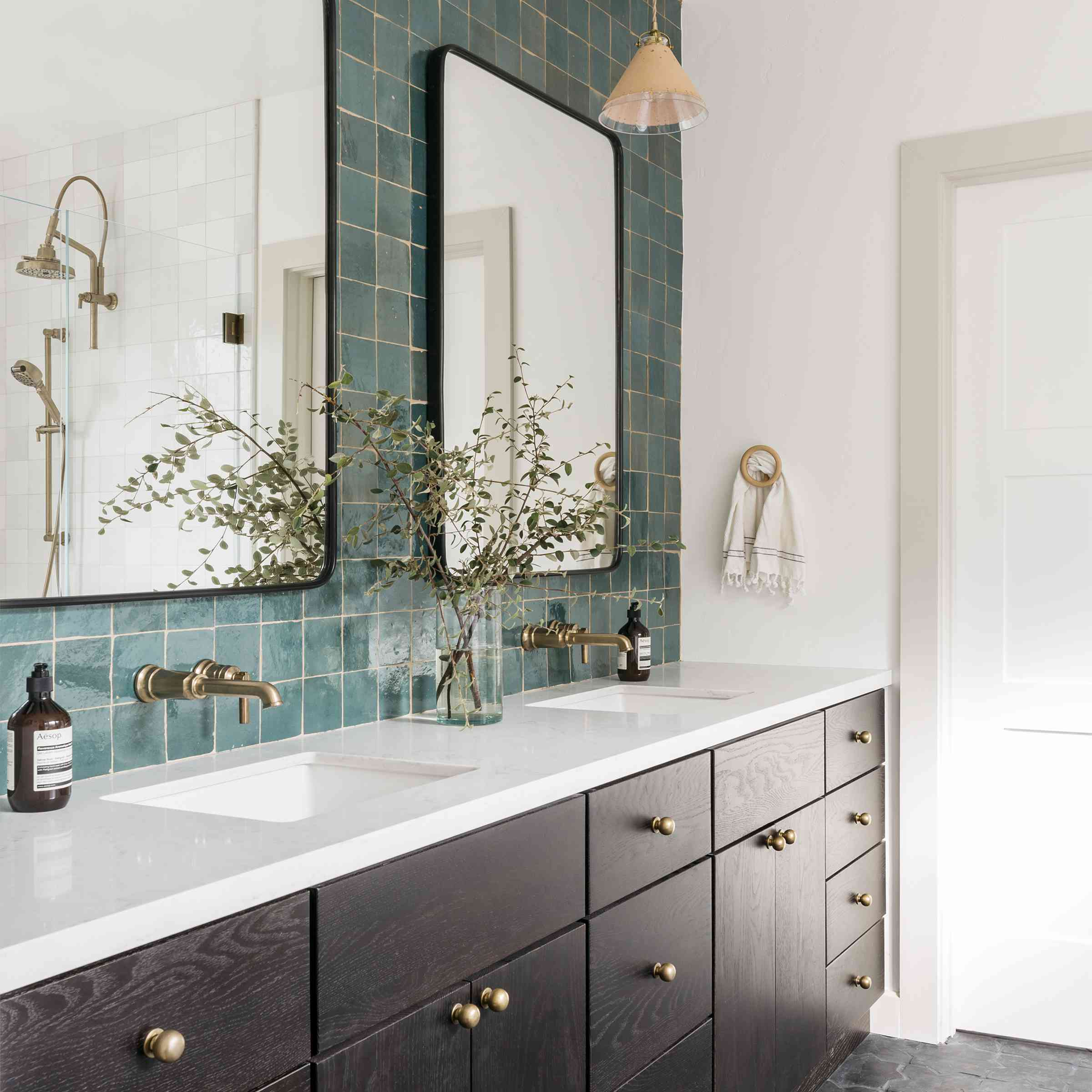 Brett Foken home tour - bathroom with teal tile and dark walnut cabinets
