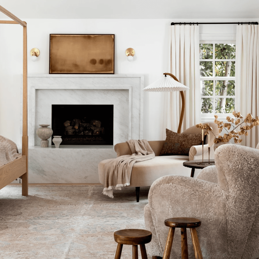 A neutral-filled room with a striking fan floor lamp