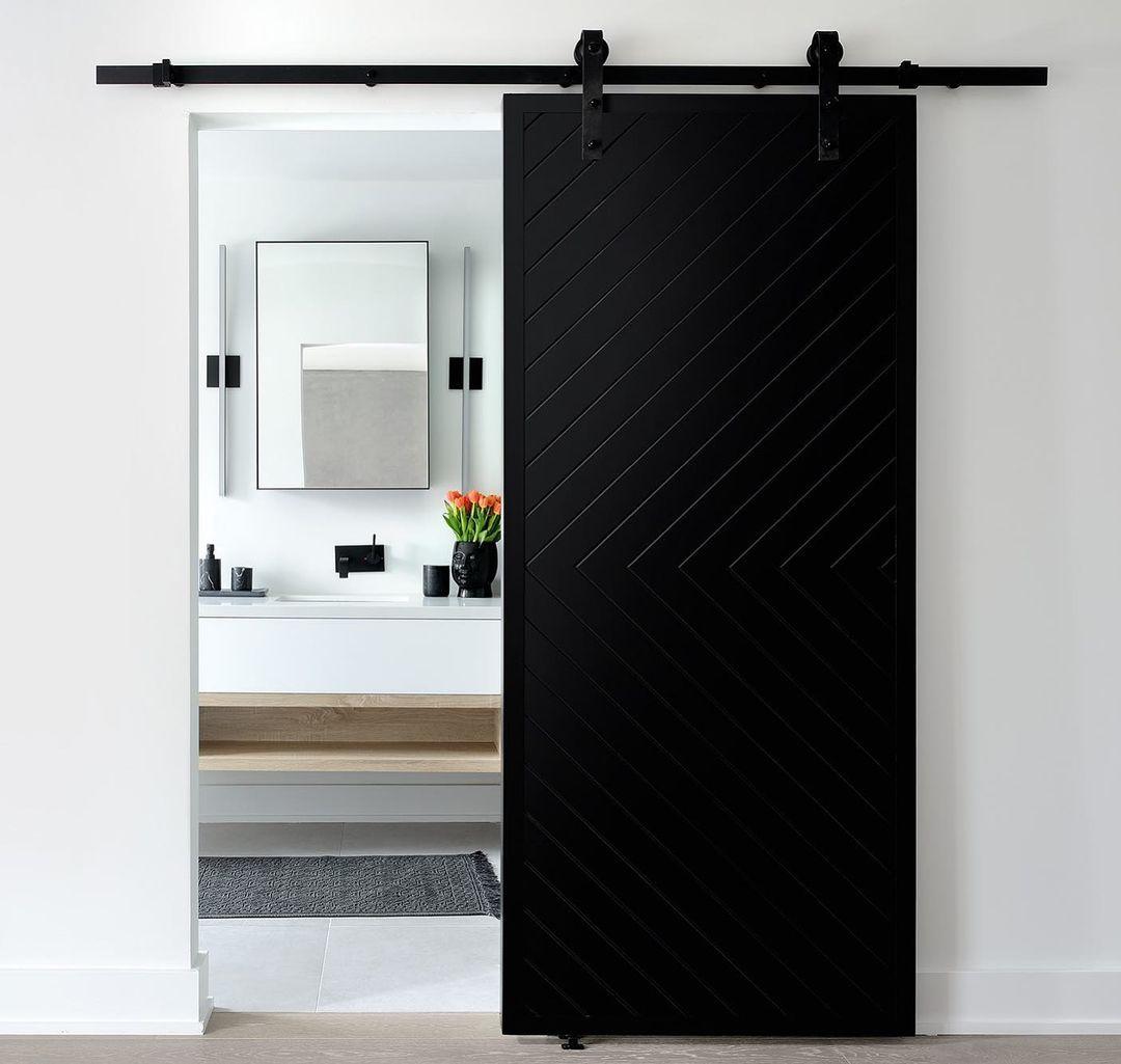 Black barn door in a bathroom