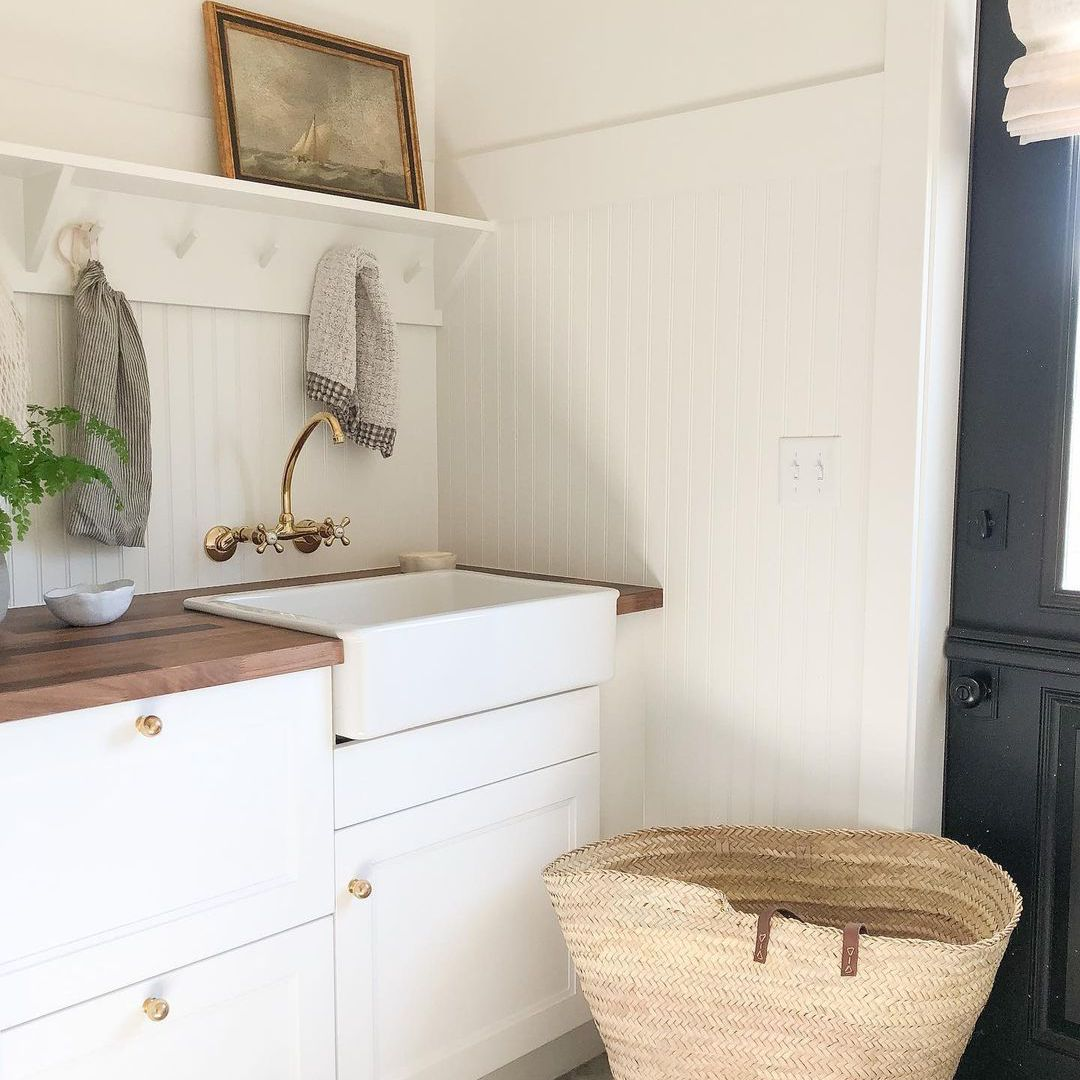 Laundry room with shelf above sink