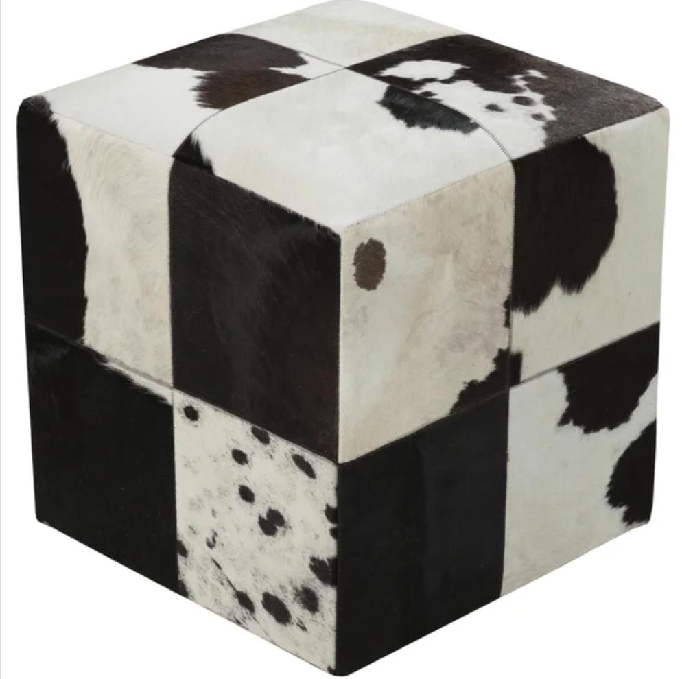 otomana cuadrada de piel de vaca