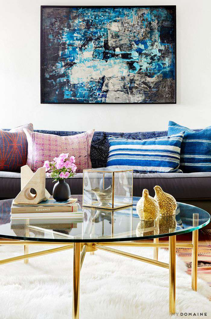 Mix of pillows and textures in a midcentury-inspired living room