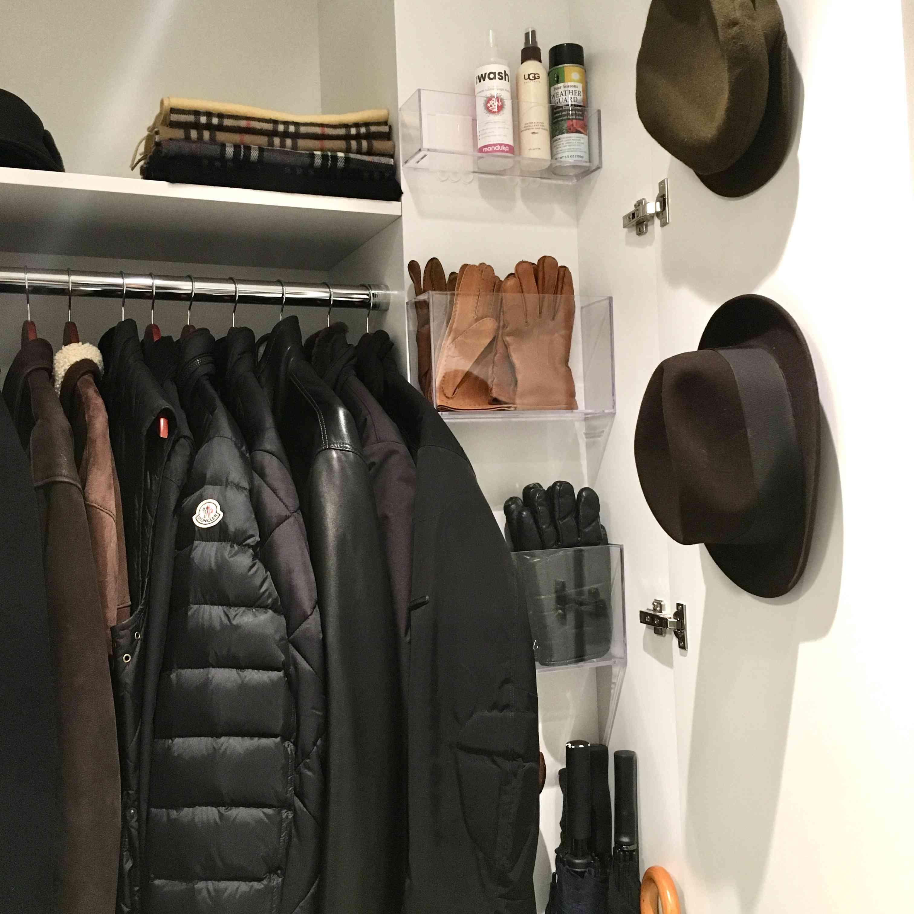 Closet with hats hanging