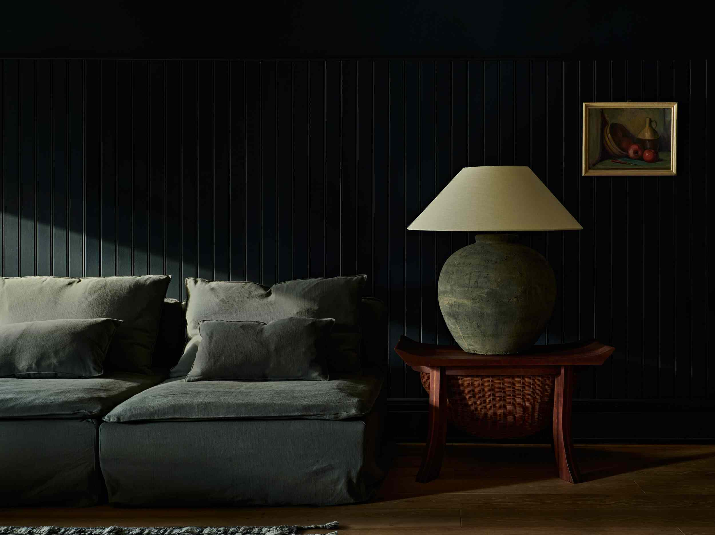 Dark and moody living room with paneling