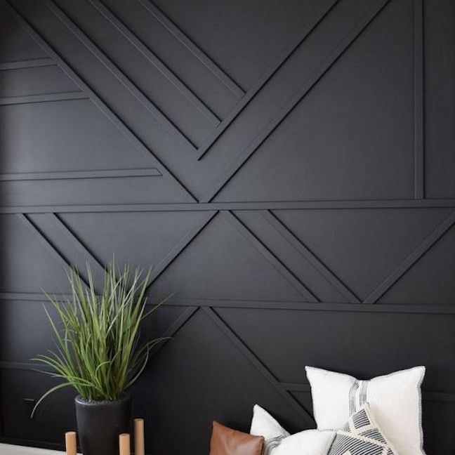 Black wall with built-in wooden detail.