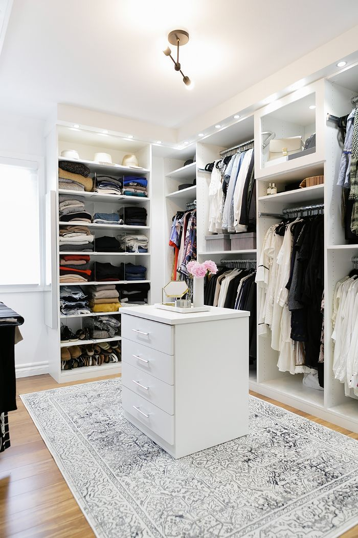 Walk in closet with bright white built-ins