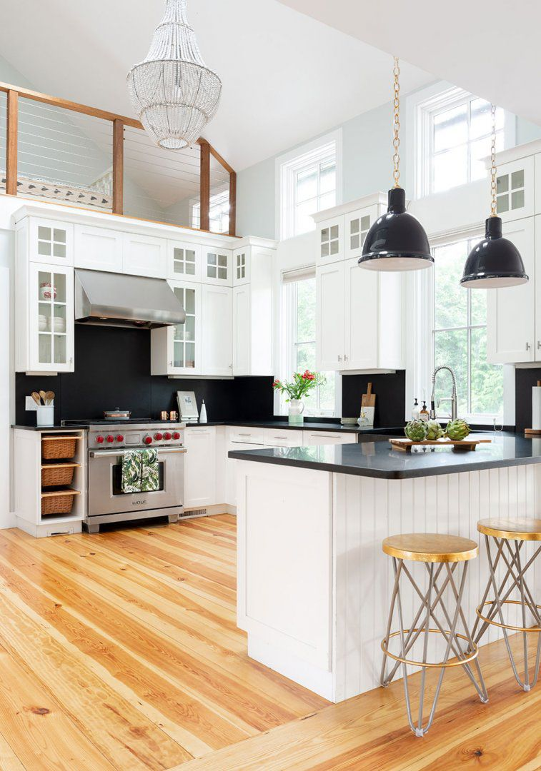 best kitchen ideas - black and white kitchen with light wood flooring
