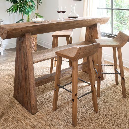 hewn wood bar counter and stools