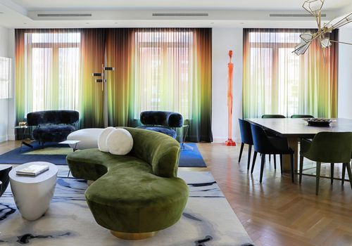 Living room with rainbow curtains.