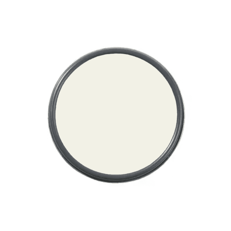 An overhead shot of a paint can with white paint in it