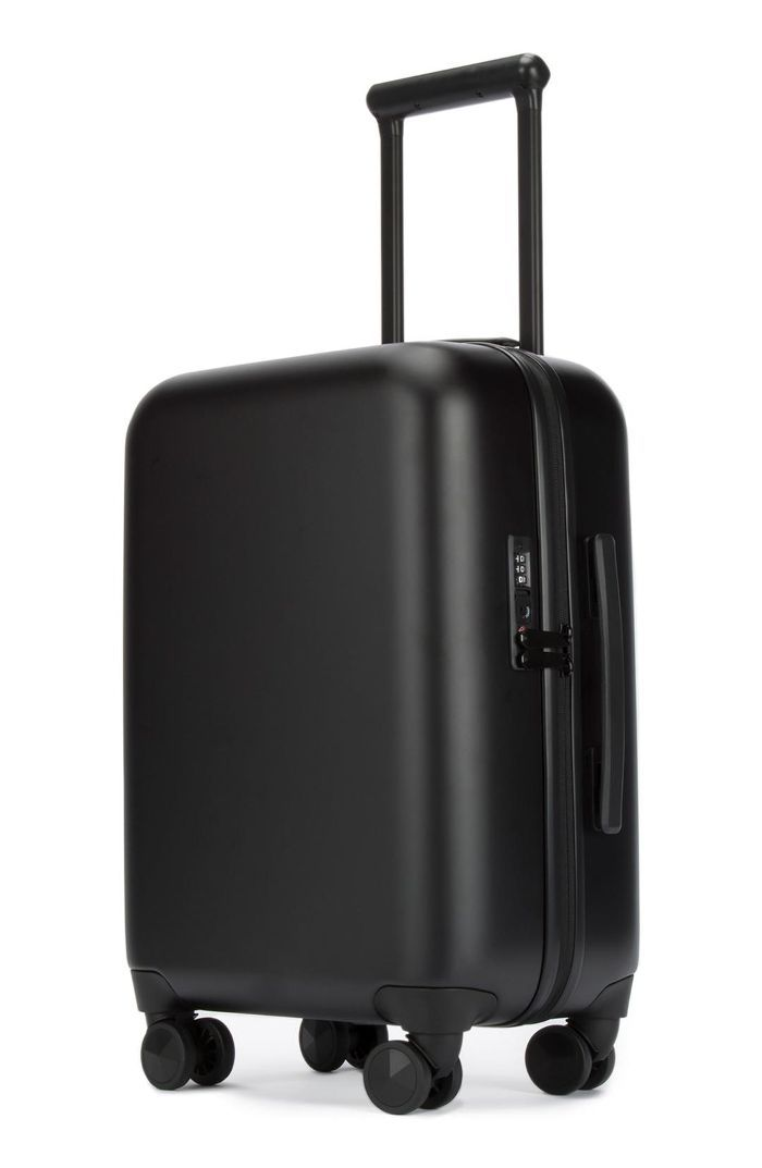 Rebecca Minkoff 22-Inch Charging Spinner Suitcase How Early to Arrive at the Airport
