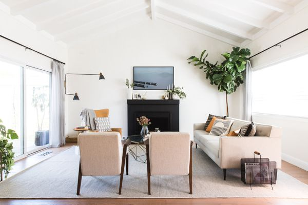 best home products June - beautiful family room with pink chairs and couch