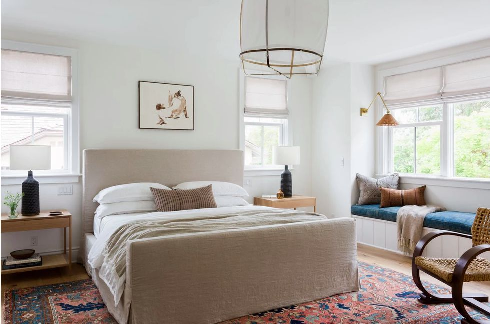 cream colored bed with fabric upholstery