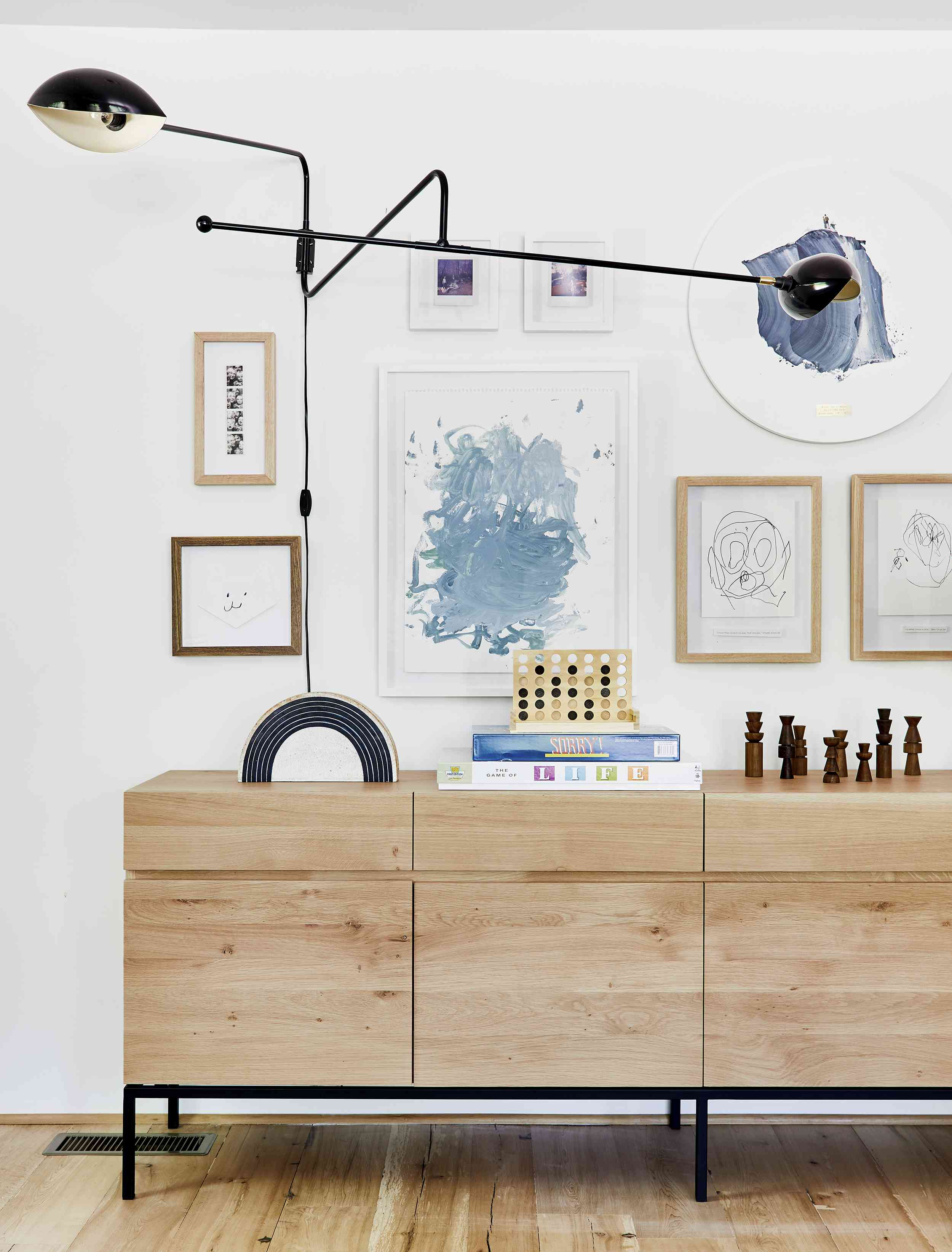 Living room gallery wall with a family focus
