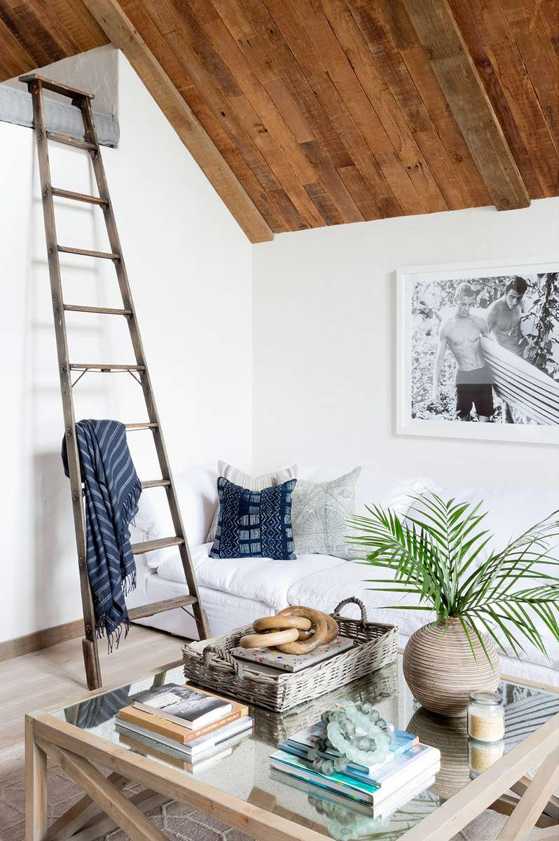 Rustic modern living nook with reclaimed wood ceiling
