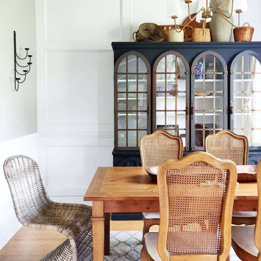 Traditional formal dining room with wooden chairs.