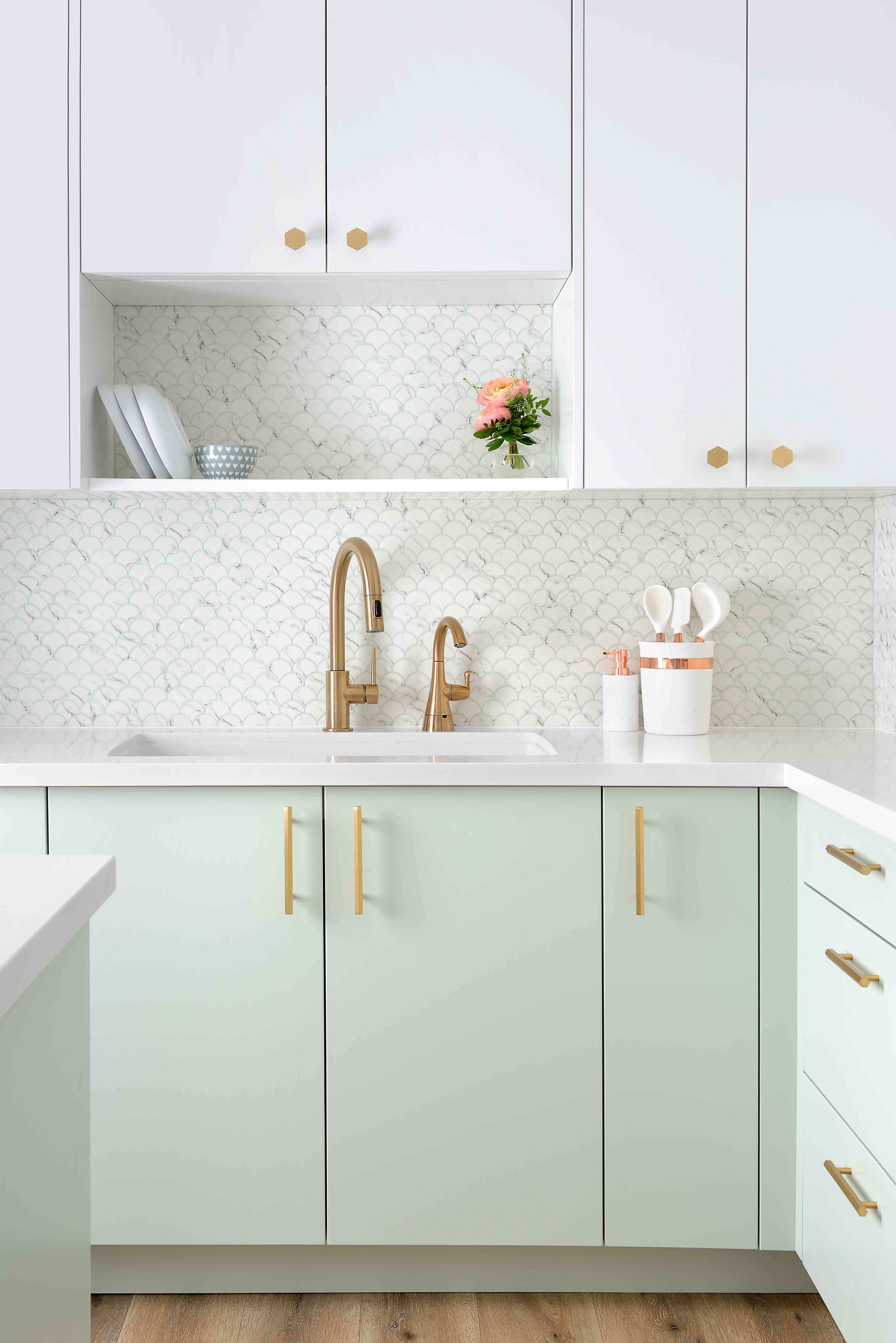 Mint green kitchen with fish scale marble