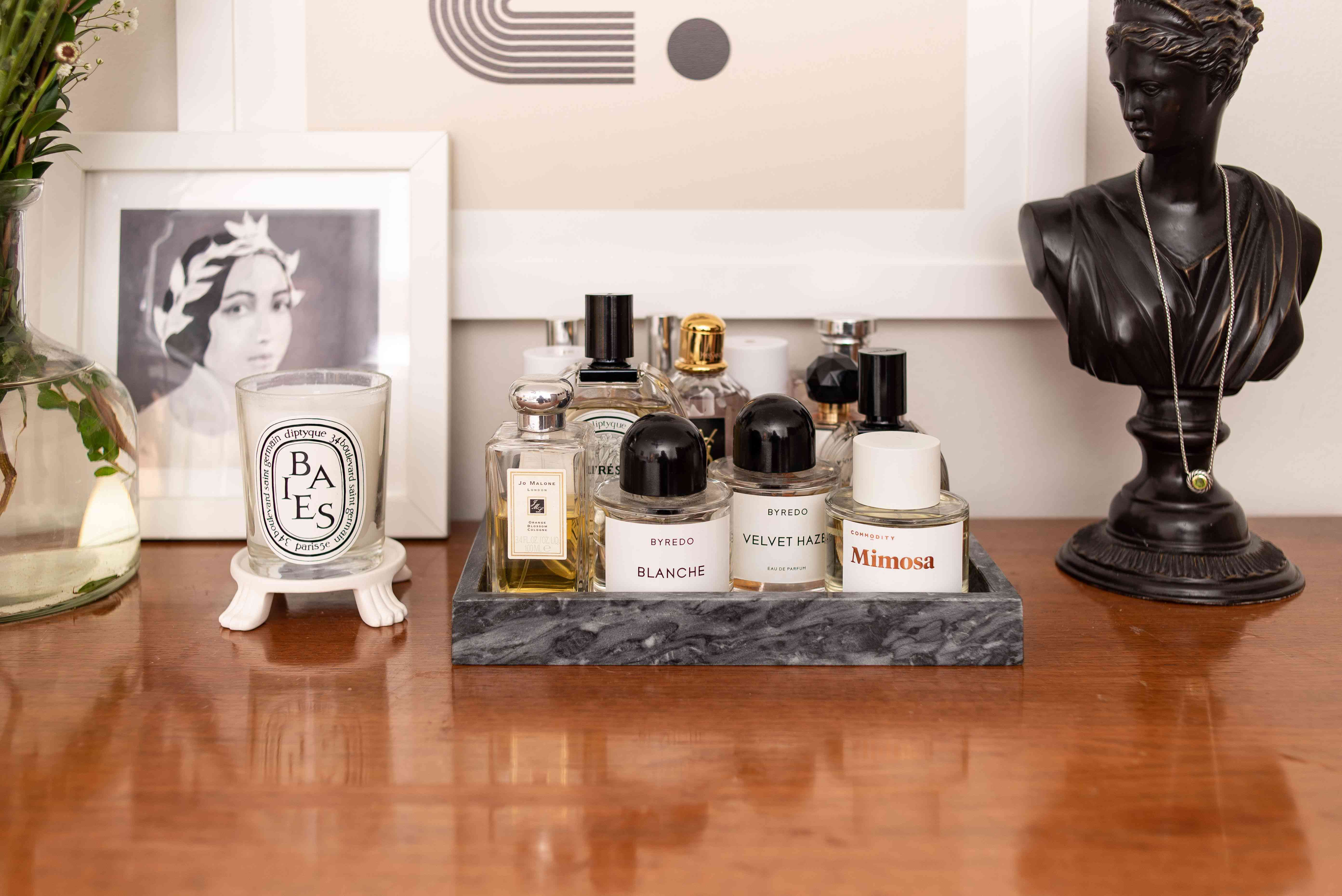 Perfumes and bust statue.