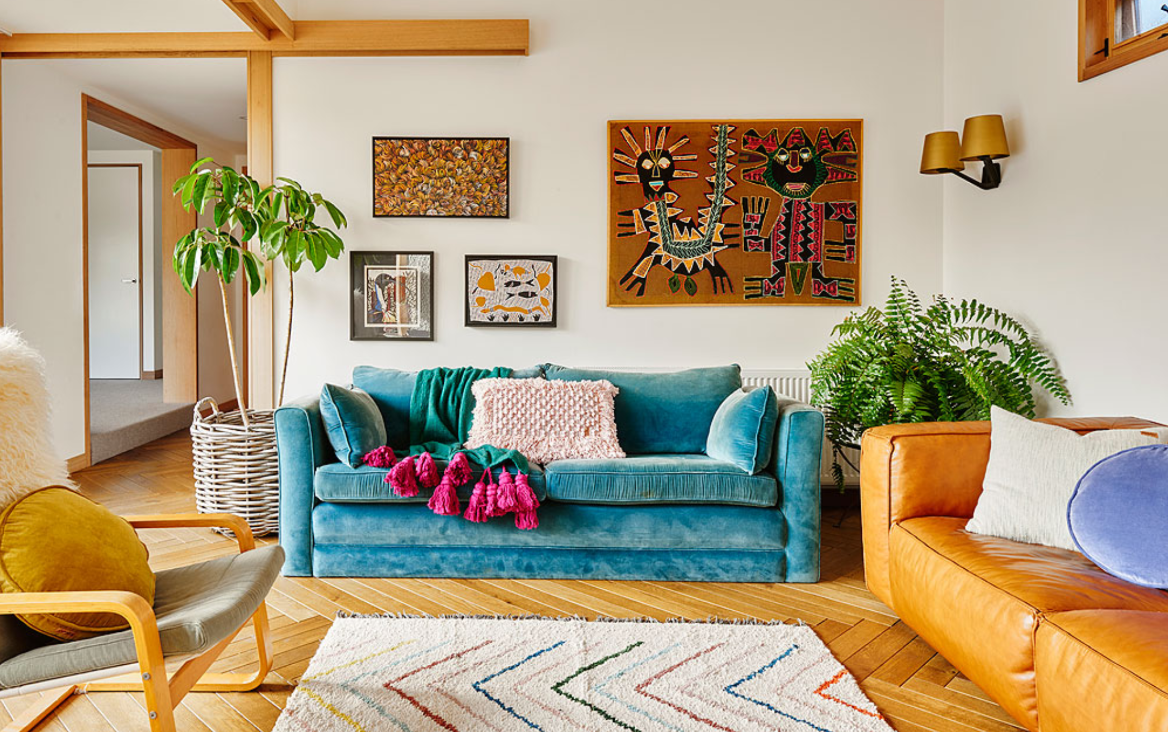 Bohemian-inspired home with turquoise couch and tribal art