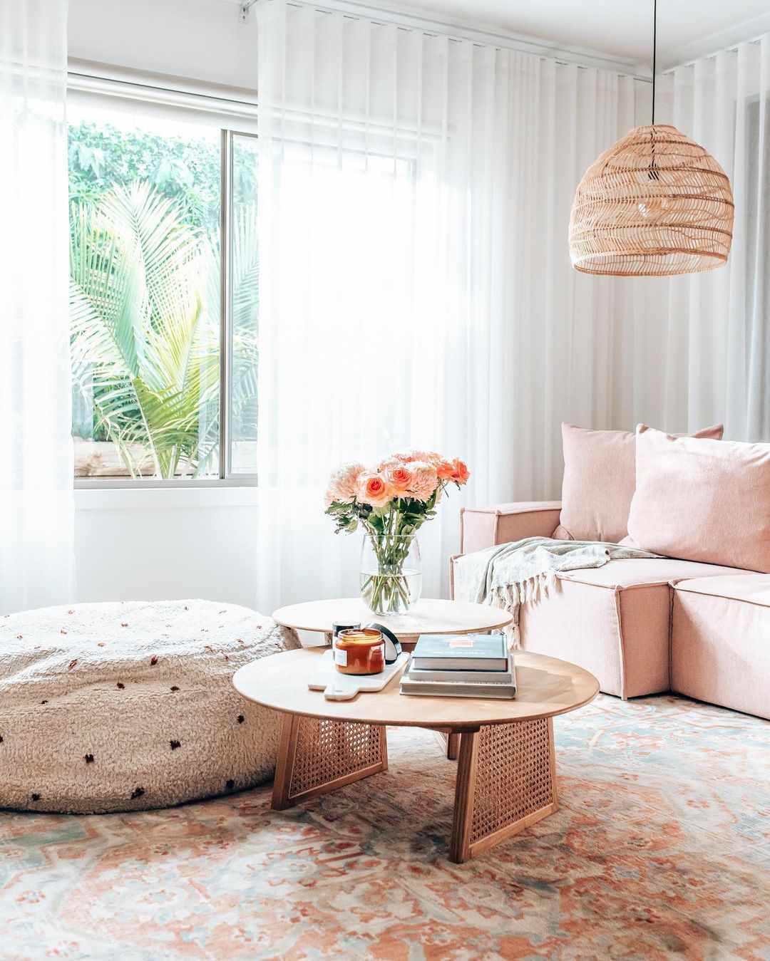 Pink living room sofa with shearling ottoman.
