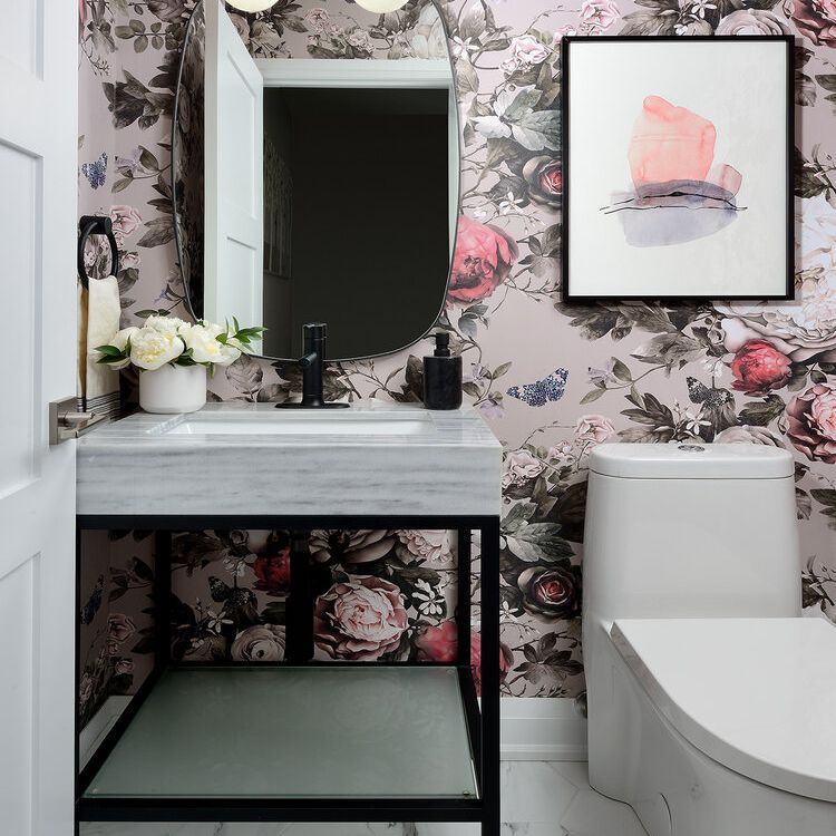 Bathroom with bold floral wallpaper.