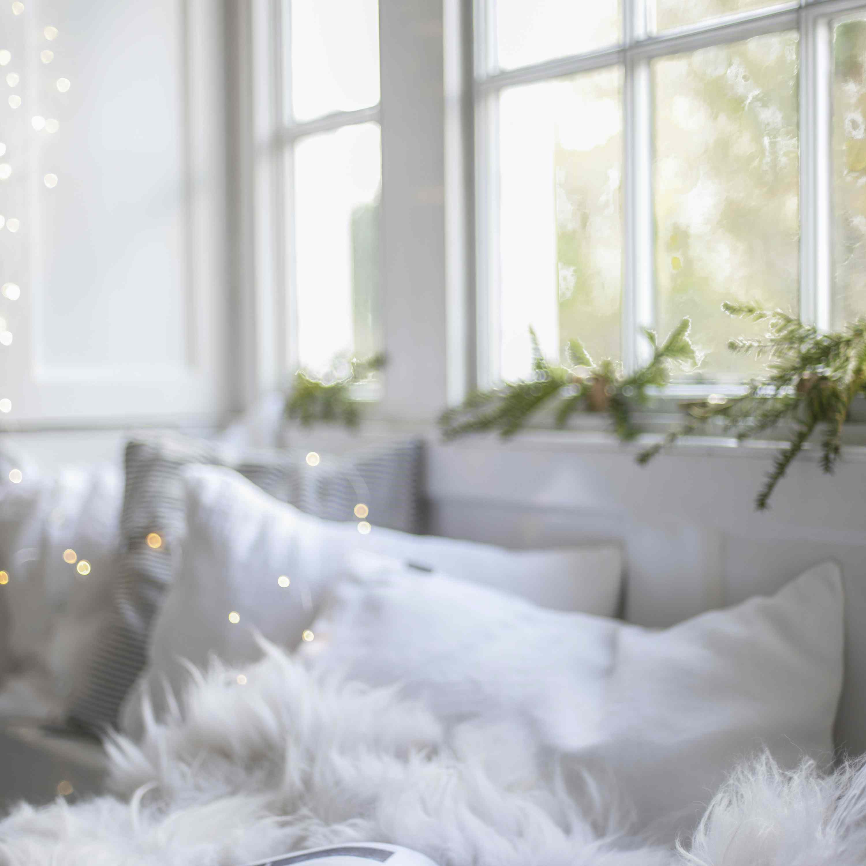White cozy bedroom with pine accents.
