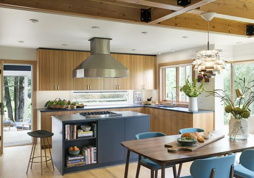 Bright kitchen with light wooden cabinets.